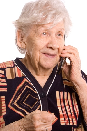 The elderly woman speaks on phone photo