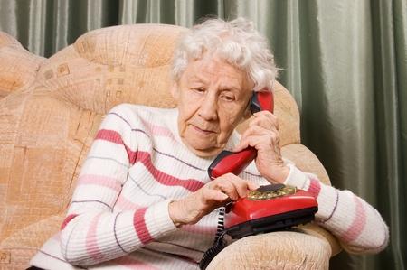 The elderly woman speaks on phone Stock Photo - 9545483