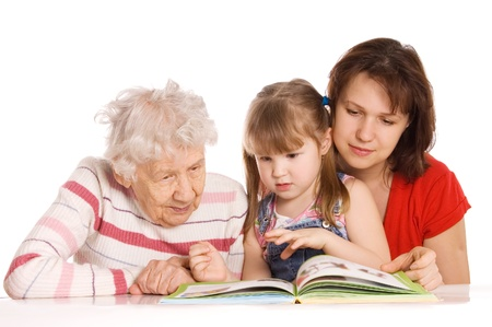grand parents: Grandmother with the grand daughter read the book