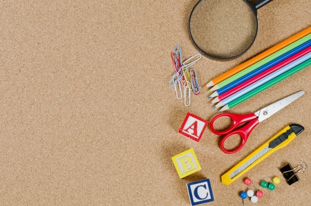 Various school accessories on �orkboard Stock Photo - 9545578