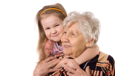 The elderly woman with grand daughter photo