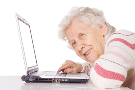 e pretty: The elderly woman at the computer Stock Photo
