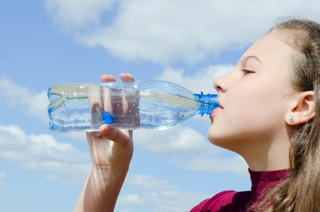 The girl drinks water photo