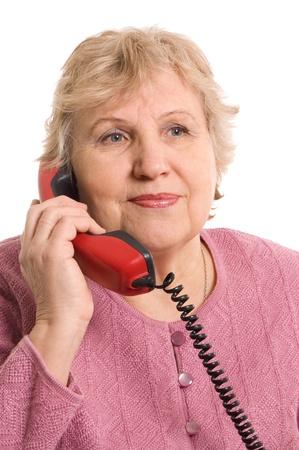speaks: The elderly woman speaks on phone