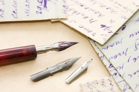 prose: Old letters and pen as background