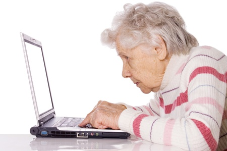 computer learning: The elderly woman at the computer Stock Photo