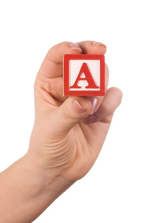 Hand holds a cube with letters Stock Photo - 9609888