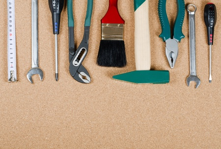 toolbox: Building tools on a corkboard Stock Photo