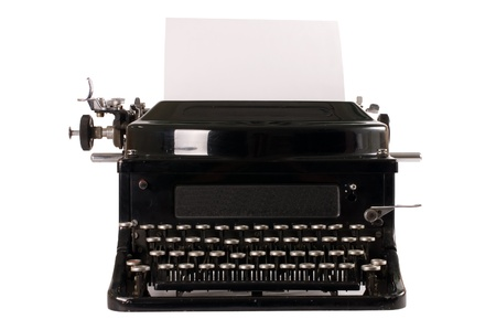 Old typewriter isolated on white background photo