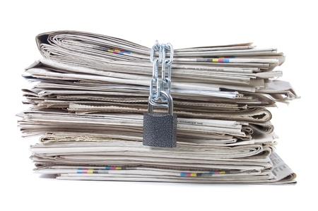 human rights: pile of newspapers with chains