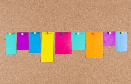 collection of note papers on corkboard photo