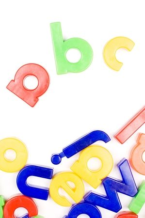 Plastic English letters isolated on white background photo