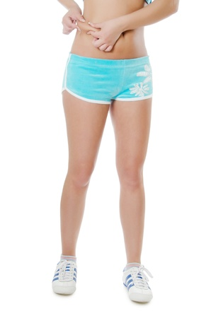 paunch: Sports girl in shorts isolated on white Stock Photo