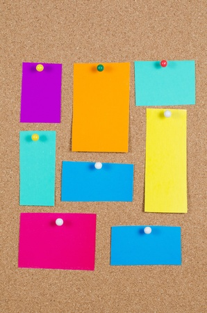 collection of various note papers on corkboard photo