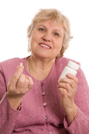 Elderly woman with tablets isolated on white Stock Photo - 9921780