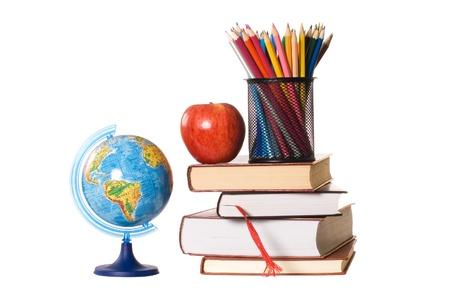 The globe on books isolated on white photo