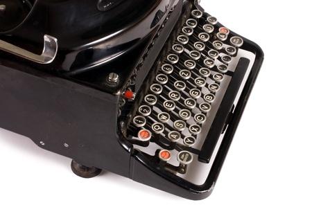 Old typewriter isolated on a white background photo