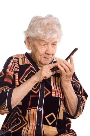 The elderly woman speaks on the phone Stock Photo - 9921735