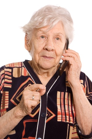 The elderly woman speaks on the phone photo