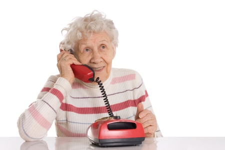 The elderly woman speaks on the phone Stock Photo - 9921638