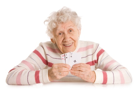 Old woman with cards isolated on white Stock Photo - 9921671