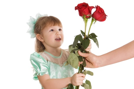 gives: Little girl gives a bouquet of roses