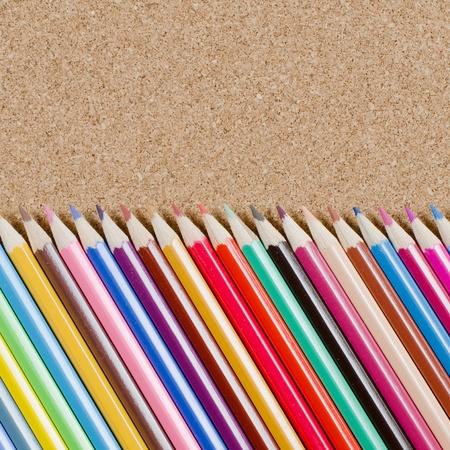 The colour pencils on сorkboard. School concept photo