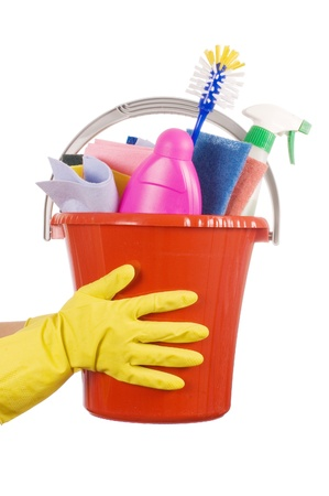 Plastic bucket with cleaning supplies over white photo