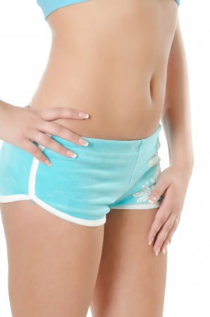 Body of the girl in blue shorts Stock Photo - 9944838