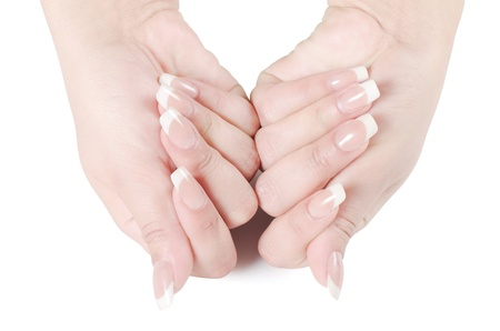 Beautiful female hands with the French manicure photo