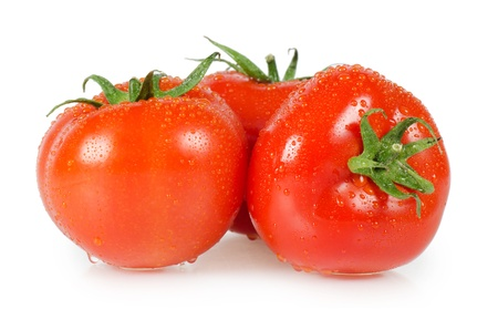The red tomato isolated on white background photo