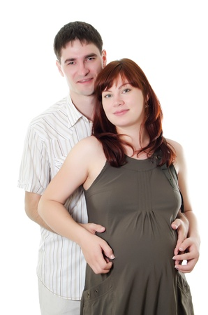 Happy pregnant couple isolated on white background Stock Photo - 10036465