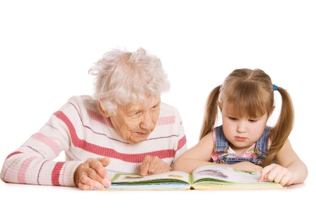 grand daughter: Grandmother with grand daughter read the book