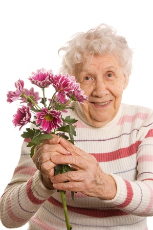 maturity: Old woman with a bunch of flowers Stock Photo