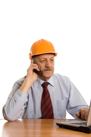 Engineer speaks by phone isolated on white photo