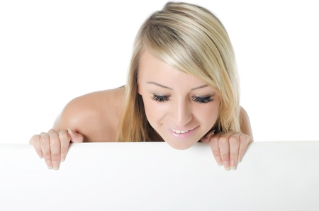 Portrait of woman holding a blank billboard Stock Photo - 10128734