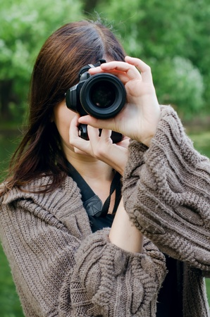 Young girl with the camera in park Stock Photo - 10216466
