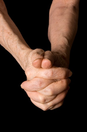 Hands of old woman on black background Stock Photo - 10216265