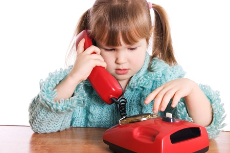 The little girl speaks by phone isolated Stock Photo - 10574719