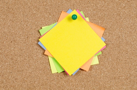 cork sheet: collection of various note papers on corkboard