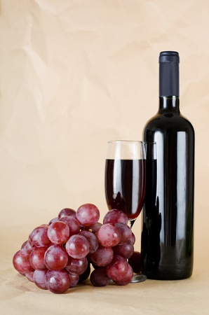 Red wine glass on vintage a background Stock Photo - 10574870