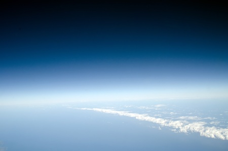 View above earth at the clouds below photo
