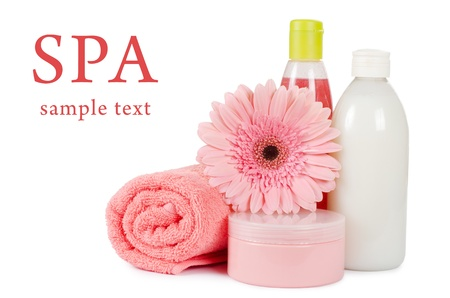 toiletry: Pink gerbera and towel isolated on white Stock Photo