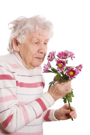 The old woman with bunch of flowers photo