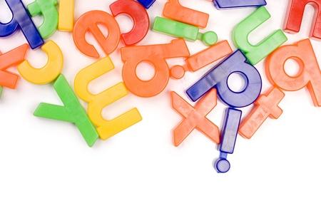 Plastic English letters isolated on white background photo