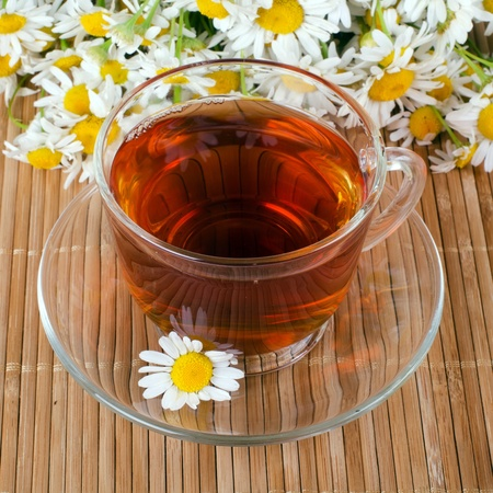 chamomile tea: Glass cup with fragrant a camomile tea