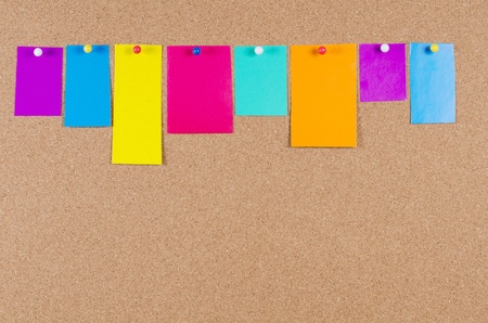 a bulletin board: collection of various note papers on corkboard