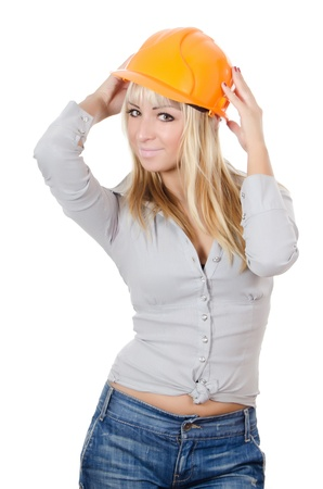 The beautiful girl in a building helmet photo