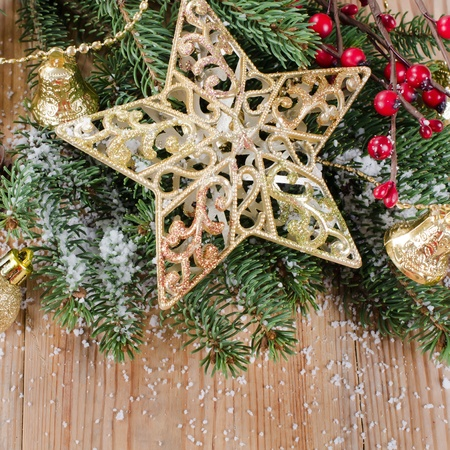 group of christmas baubles: The christmas decorative border on wooden background