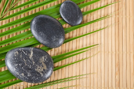 The spa a stone on bamboo background Stock Photo - 11210498